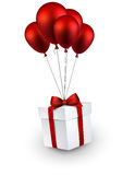 Gift box on red balloons Royalty Free Stock Image