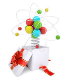 Gift box with red band and colorful atom structure Stock Image