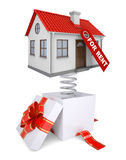 Gift box with red band and house for rent Stock Photos