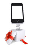 Gift box with red band and smartphone on spring Stock Photography