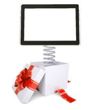 Gift box with red band and tablet Stock Photos