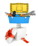 Gift box with red band and toolbox Stock Images