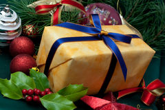gift box,with red and blue ribbon, on  textile ba Royalty Free Stock Image
