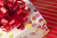 Gift box with red bow Stock Photography