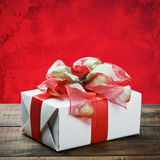 Gift box with a red bow Stock Photography