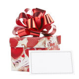 Gift box with red bow and blank card Royalty Free Stock Photos