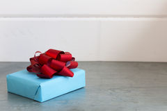 Gift box with a red bow. Close up royalty free stock image