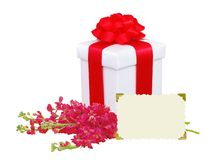 Gift box with red bow, flowers and greeting card isolated on whi Stock Photo