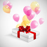 Gift box with red bow and flying balloons. Gift box with red bow and flying  transparent balloons Stock Image