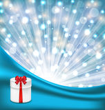 Gift box with red bow on glowing background Stock Photos