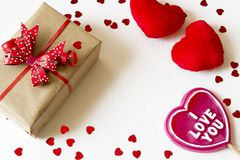 Gift box with red bow, red hearts and i love you lollipop. Gift box with red bow, red hearts and lollipop with i love you inscription. Present for valentine`s Royalty Free Stock Images