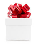 Gift box with red bow isolated on the white background Stock Photography