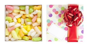 Gift box with red bow and polyfoam royalty free stock photography