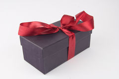 Gift box with a red bow and ribbon Stock Image