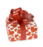 Gift box with a red bow and ribbon. On a white background Royalty Free Stock Photography