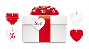 Gift box with red bow, ribbon and set of heart-sha. Ped tags. just add your text to the tag or use any tag from set. it's easy replaceable Stock Image