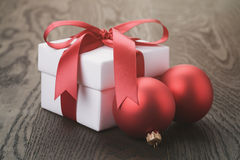 Gift box with red bow on rustic table Royalty Free Stock Photo