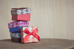 Gift box with red bow on wood background Stock Image