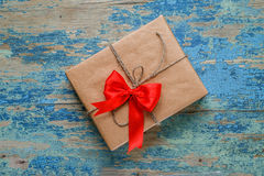 Gift box with a red bow Stock Image