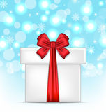Gift box with red bows on glowing background Stock Photo