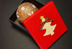Gift box in red with Christmas ball, close-up royalty free stock images