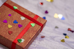 Gift box of red color with colored hearts, Valentine's Day, wedding Stock Images