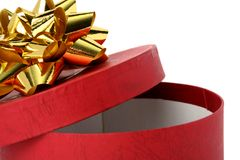 Gift box of red color with a golden bow Stock Image