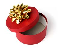 Gift box of red color with a golden bow Royalty Free Stock Image