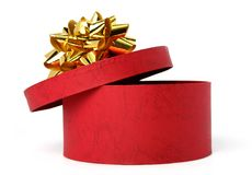 Gift box of red color with a golden bow Stock Photo