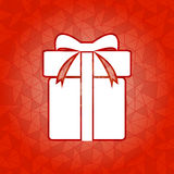 Gift box on red dazzled triangle background Royalty Free Stock Photography