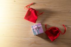 Gift box and Red Gift Bag wrapped Christmas and Newyear presents with bows and ribbons, Christmas frame boxing day background. Gift box and Red Gift Bag wrapped stock image