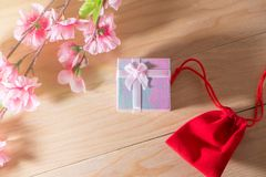 Gift box and Red Gift Bag wrapped and plum blossom Christmas and Newyear presents with bows and ribbons, Christmas frame boxing. Gift box and Red Gift Bag Royalty Free Stock Photos