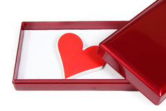 Gift box with red heart. Inside on white background Stock Image