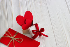 Gift box with a red heart inside on a white old wooden table. Va. Lentine day Royalty Free Stock Image