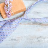 Gift box with red heart and ribbon, blue tie and Father`s day card . Striped tie near present box. Best quality gifts. Gift present box, blue tie and Happy royalty free stock photography