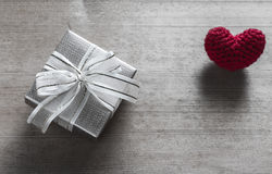 Gift Box and Red Heart Shaped Silk Stock Photo