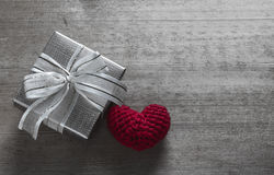 Gift Box and Red Heart Shaped Silk Stock Photos