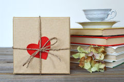 Gift box and red heart shaped tag Stock Photo