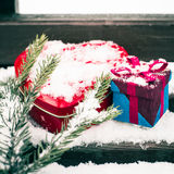 A gift box with red heart shaped tin box Royalty Free Stock Images
