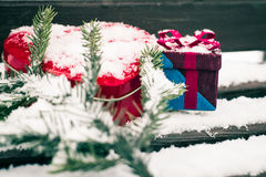 A gift box with red heart shaped tin box Royalty Free Stock Image
