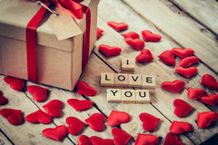 Gift box and red heart with wooden text for I LOVE YOU on wood t. Able background Stock Images