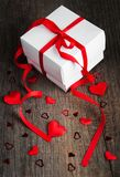 Gift box with red hearts. Valentines holiday concept Stock Images