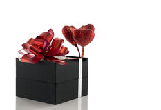 Gift box with red hearts. Gift box with red heart shapes and bow Royalty Free Stock Photography