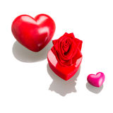 Gift box with red hearts for valentines on white Royalty Free Stock Photos