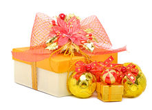 Gift box with red mesh bow and christmas baubles Stock Images