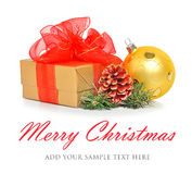 Gift box with red mesh bow, christmas baubles and cone Royalty Free Stock Photography