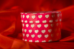 Gift box on red organza background Stock Image