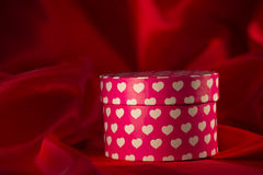 Gift box on red organza background Royalty Free Stock Image