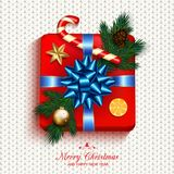 Gift box red present in gold ribbon bow with fir tree, candy can. E, golden star and bubble. Square gift box for Christmas or New Year Holiday greeting card Stock Photo