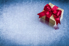 Gift box with red present tape on metallic surface copyspace Royalty Free Stock Photo